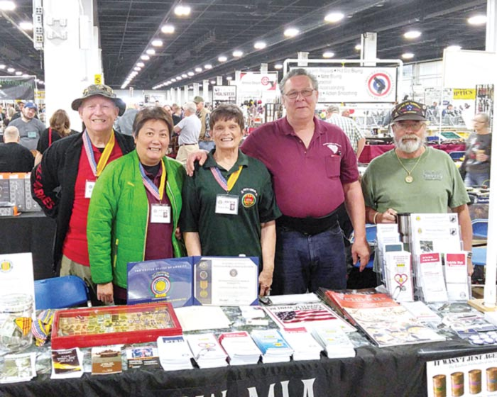 Member of Vietnam Veterans of America talked with visitors about Vietnam issues and the lingering effects of Agent Orange at the TD Convention Center Gun Show. Left to right: Ron Hall, Bang Hall, Nancy Nix, Duane Kelley and Johnny Cotrone.