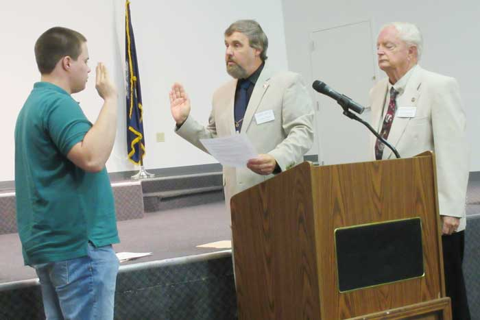 Brian Poerschman is sworn in as a new member of the 16th Regiment, SC, Volunteers, Camp 36 of the Sons of Confederate Veterans. He was sworn in by Camp Commander Frank Tucker as 1st Lt. Commander Larry Waddell looks on.