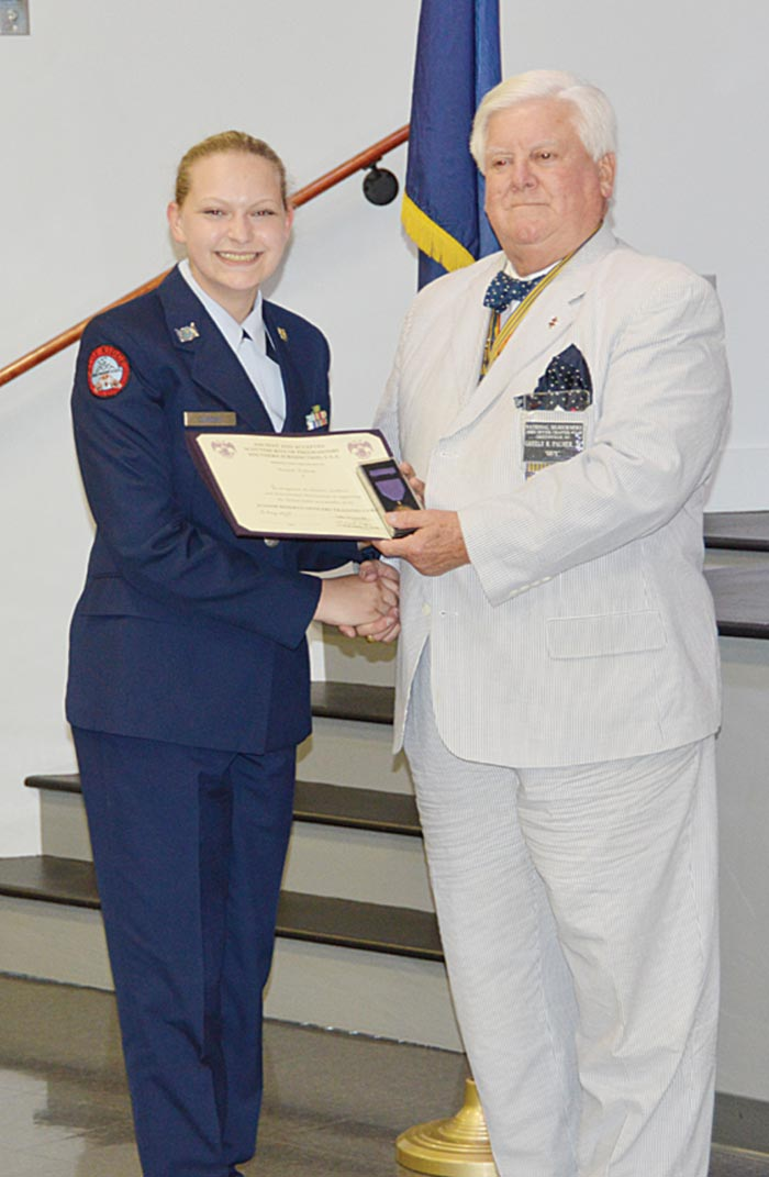 Cadet Hannah Dubose is presented the Ancient and Accepted Scottish Rite of Free Masonry Certificate and Medal by Maj. Guy Palmer, US Army (Ret).