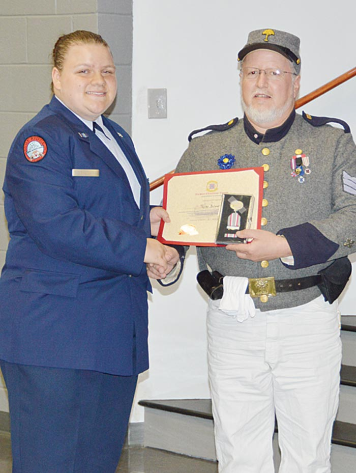 Cadet Taylor Brown is presented  the Sons of Confederate Veterans – H.L. Hunley Award Certificate and Medal by Nelson Bishop,  16th Regiment (SCV).
