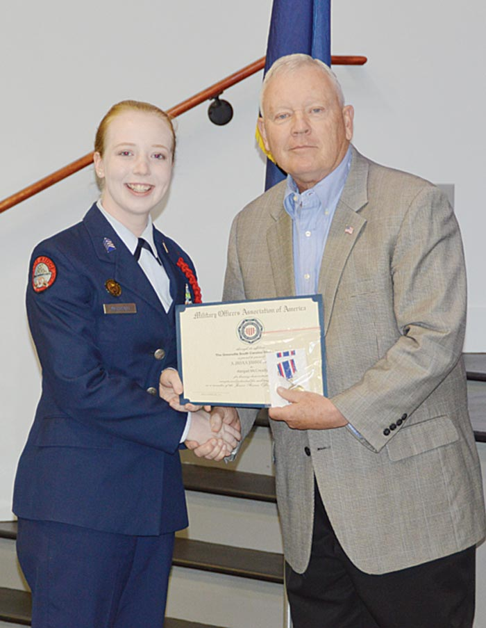 Cadet Capt. Abigail McCready is presented the Military Officers Association of America (MOAA) Certificate and Medal by  Col. Bill Kohler, (Ret).