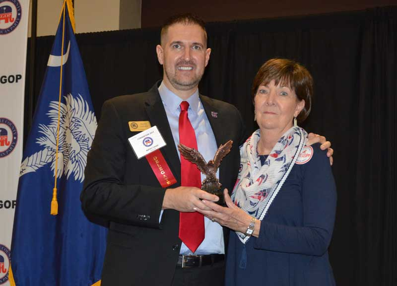Gayle Stanley receives a Special Service Award from GOP Chairman Leupp. - Photo by Gilbert Scales