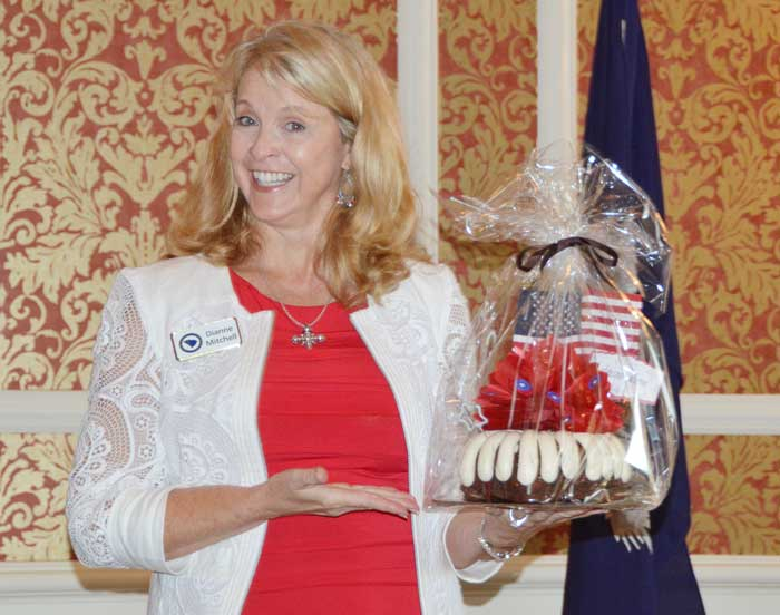 Greenville County Republican Women's Club 1st Vice President Dianne Mitchell holds a patriotic cake baked by Nothing Bundt Cakes® which was raffled off to those who attended the GCRWC Americanism Luncheon.