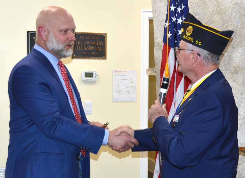 Post 214 Commander Clyde Rector thanks Producer Erik Weir (Greenville Resident for 11 years) for speaking at American Legion Post 214 Taylors.