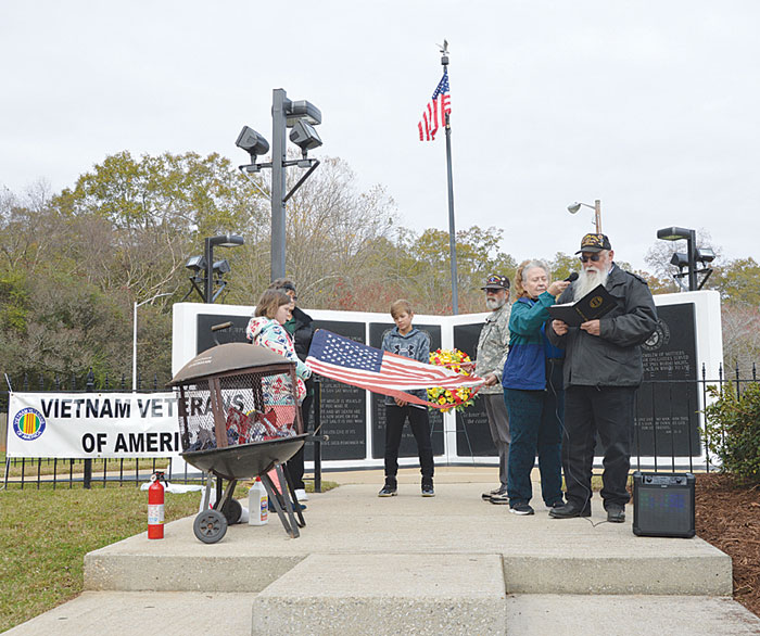Vietnam Veterans of America perform a  Flag Retirement Ceremony on Veterans Day at  Cleveland Park's Vietnam Veteran Memorial with  the help of those attending.