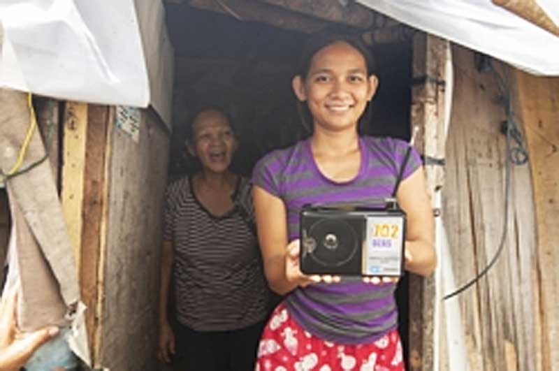 FEBC's free radio giveaway provides sets that enable people who would otherwise have no access to Christian broadcasting to hear the gospel, like this recipient in the Philippines.