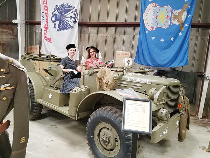 Heather & Raquelle Sheen pose in a 1943 Dodge WC56 Command and Reconnaissance car.