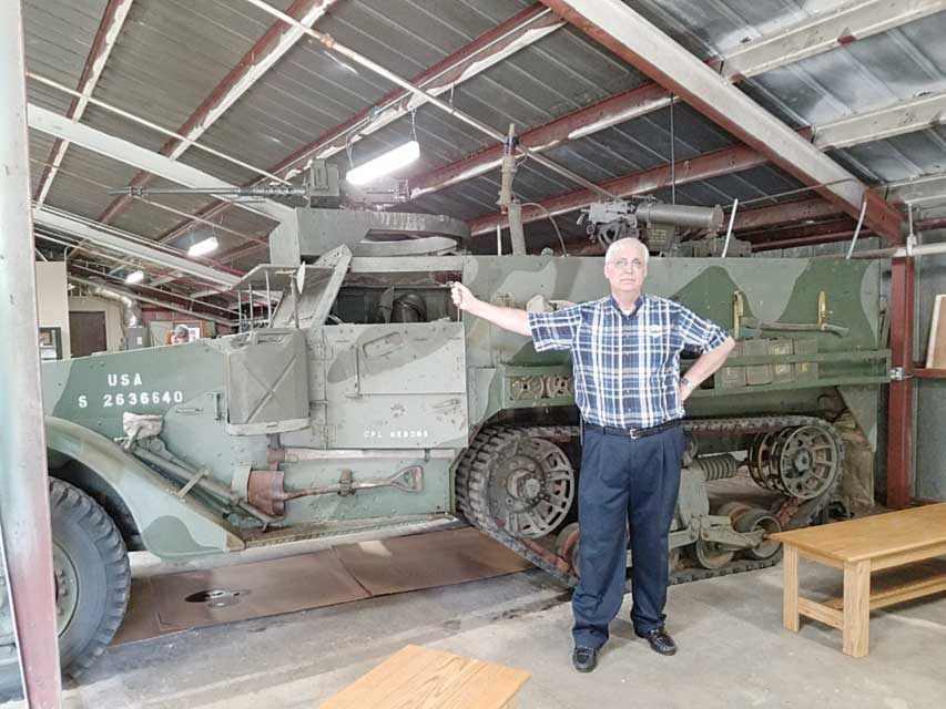 Ray Sheen stands by a Korean War half-track, the type his father George Sheen, commanded in the war. - Photo by Holly Sheen
