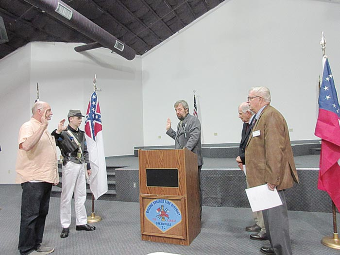 Clyde W. Rector, at left, and Jackson Lee Tucker were sworn in as new members of the Sons of Confederate Veterans by 16th Regiment Commander Frank Tucker, Camp Chaplain Pastor  Mark Evans and Larry Waddell.