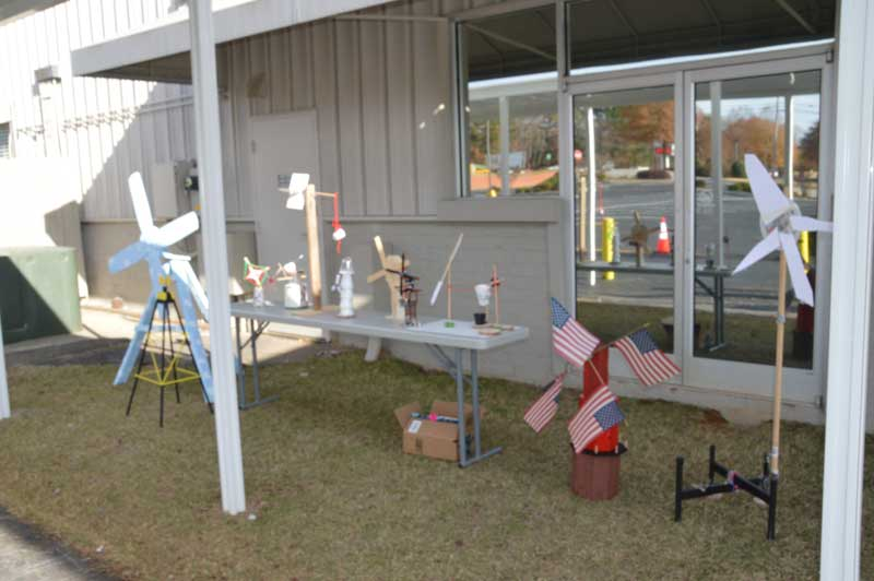 Lakes & Bridges science students display their projects outside the school.