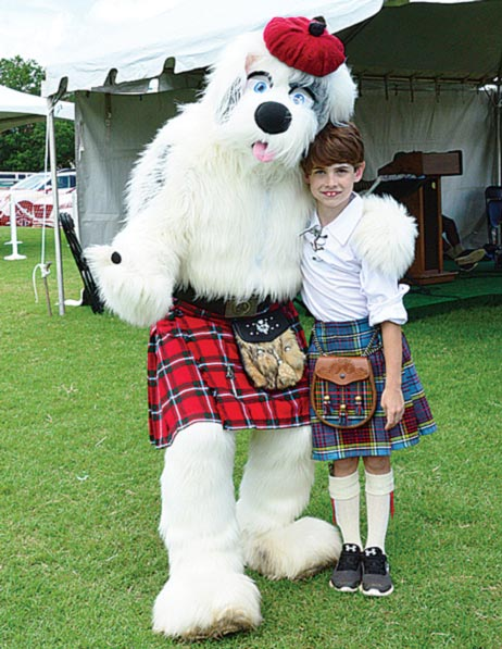 Thomas Anderson, age 10, made friends with Shaemus McDuff (Dog) at this years Highland Games at Furman University. (Photo by Tony Dunn)